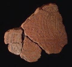 11. Terra cotta fragment