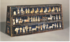 16. Standard of Ur Location: Royal Tombs at Ur (modern-day Tell el-Muqayyar, Iraq Artist: N/A Date: 2,600-2,400 B.C.E Culture: Sumerian Period/Style: Ancient Near East Medium/Material: Wood inlaid with shells, lapis lazuli, and red limestone Theme(s): war, peace, migration Form: A trapezoidal prism that uses color, lines, and shape to show and describe times of peace conflict. Function: likely to have been the sound box for a musical instrument.  Content: The war side shows representations of a Sumerian army. Chariots, each pulled by four donkeys, trample enemies; infantry with cloaks carry spears; enemy soldiers are killed with axes, others are paraded naked and presented to the king who holds a spear. The peace panel shows animals, fish and other goods brought in procession to a banquet.  Context: found in one of the largest graves in the Royal Cemetery at Ur, lying in the corner of a chamber above a soldier who is believed to have carried it on a long pole as a standard, the royal emblem of a king.