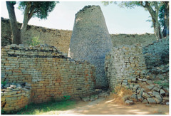 167. Conical tower of Great Zimbabwe/ Circular wall of Great Zimbabwe Location: Southeastern Zimbabwe Artist: (attributed to ________________) Date: c. 1000 - 1400 C.E. Culture: Shona peoples Period/Style: ... Medium/Material: Coursed granite blocks Theme(s): power, royalty Form: great grain tower within the great enclosure Function: to store grains or other food supplies  Content: tall tower that was laid in blocks that were not plastered together Context: Great Zimbabwe is a ruined city in the southeastern hills of Zimbabwe.