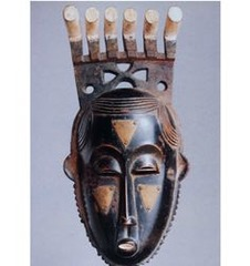 173. Portrait Mask (Mblo) Location: Côte d'Ivoire Artist: ? Date: Late 19th-20th century C.E. Culture: Baule peoples Period/Style: ... Medium/Material: wood and pigment Theme(s): entertainment Form: crowned with a fantastical series of wild-animal horns; departure from a rigidly symmetrical representation suggests an individual physiognomy/expression (met) Function: appeared as the final sequence of an operatic public entertainment known as Mblo (met) Content: diversity is often apparent in imaginative decorative passages extending above the face (horns); broad forehead and downcast eyes are classic features associated with intellect and respect (met) Context: Mblo performances consist of a succession of dances that escalate in complexity and importance, culminating ultimately in tributes to the community's most distinguished member. Individuals honored in this way are depicted by a mask that is conceived of as their artistic double or namesake. (Metro Museum) Cross Cultural Connection(s): Camelid sacrum in the shape of a canine, masquerades