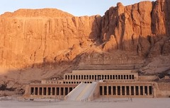 21. Mortuary temple of Hatshepsut Location: Near Luxor, Egypt Artist: Senmut Date: c. 1473-1458 B.C.E.  Culture: Egyptian Period/Style: Ancient Egyptian Medium/Material: Sandstone, partially carved into a rock cliff, and red granite Theme(s): royalty, achievement Form: Temple: Space and form to create a opening inside. Statue: The way the body is made brings attention to the head and face. The form and value acts as a gradient from bottom to top. Function: Funerary temple for the queen of the time  Content:  Context: Built for the queen to commemorate her achievements and act as a mortuary for her and a sanctuary for the god Amun-ra