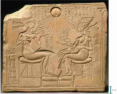 22. Akhenaton, Nefertiti, and three daughters Location: New Kingdom, 18th Dynasty Artist: N/A  Date: c. 1353-1335 B.C.E.  Culture: Egyptian Period/Style: Ancient Egyptian Medium/Material: Limestone Theme(s): religion Form: Shape, line, and value used to form the figures and their surroundings. Function: Depict Akhenaten and his wife and their relation to the new god, Aten Content: Lines at the top point either to Akhenaten and his wife or to the circular shape in the top middle Context: A piece that would be in someone's home home, not in a public place, depicting relation between the ruler and the god