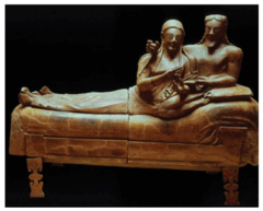 29. Sarcophagus of the Spouses Location: Cerverteri, Italy Artist: N/A Date: c. 520 B.C.E. Culture: Etruscan Period/Style: Archaic period Medium/Material: terracotta Theme(s): freedom, death Form: shape, form, and value add up to each other to allow for lighting differences. Function: Sarcoughagus containing the ashes of the deceased; funerary monument Content: Detail in hair color; portrayed women's relative freedom in Etruscan society; terracotta, funerary monument, sarcophagus, gender relations/ gender roles, expressive figures, unrealistic proportions Context: The couple are lounging on a banquet couch for what might be a funeral banquent for the dead.