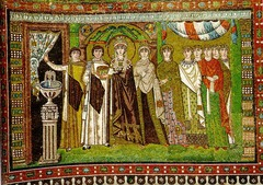 51c. Theodora and Attendants Location: San Vitale; Ravenna, Italy Date: c. 547 C.E. Period/Style: Early Byzantine Medium/Material: mosaic Theme(s): authority and unity between state and church, similarly to Justinian and Attendants Form: displacement of absolute symmetry with Theodora (play a secondary role to her husband) Function: depicts Theodora and her attendants participating in the Mass Content: Richly robed empress and ladies at court, stands in an architectural framework, holding a chalice for the mass, and is about to go behind the curtain, flattened and weightless Context: Three Magi, who bring gifts to the baby Jesus, are depicted in the hem of her dress, referring to a parallel between Theodora and the Magi Cross Cultural Connection(s): Dome of the Rock interior
