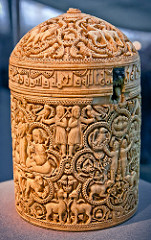 57. Pyxis of al-Mughira Date: c. 968 C.E. (Ummayad Caliphate) Period/Style: Islamic Art Medium/Material: Ivory Theme(s): arts, activity Form: horror vacui; vegetal and geometric motifs (jali?) Function: container for expensive aromatics; gift for caliph's younger son Content: eight medallion scenes showing pleasure activities of the royal court, such as: hunting, falconry, sports, and musicians Context: from Muslim Spain Cross Cultural Connection(s): Palette of King Narmer