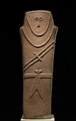6. Anthropomorphic Stele Location: Arabian Peninsula Artist: N/A Date: Fourth Millennium B.C.E (c. 4,000 B.C.E) Culture: (probably) ancient Arab Period/Style: Prehistoric, Neolithic Medium/Material: Sandstone Theme(s): ???  Form: Form used to make the figure into a human-like shape with a robe and sword. Function: unknown, but probably used for religious or burial practices Content: Distinctive belted robe and double-bladed sword, held by a human-like figure Context: Some are carved in surrounding sandstone cliffs by many Arabian tombs. Earliest known works of art from the Arabian Peninsula