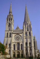 60. Chartres Cathedral Location: Chartres, France Artist:  Date: Original construction - 1145-1155 C.E. | Reconstructed - 1194 - 1220 C.E. Culture:  Period/Style: Gothic Europe Medium/Material: Limestone, stained glass Theme(s): sacred site, worship Form: enlarged chevet, vertical interior pulls viewers gaze to the heavens, mysterious interior, stained glass enliven the interior surfaces of the church Function: sacred building Content: very Romanesque, rose window is more stone than glass (plate window), burned down in 1194 and rebuilt to fit the style at the time of the rebuilding; stained glass was intended to be educational; rose window in the north transept portrays figures from the Old Testament; Royal portal has 3 entry ways with elongated figures (caryatids) Context: The cathedral's association with the Virgin Mary (the supposed veil of the Virgin is kept in the cathedral treasury) made it the destination of pilgrims in the Middle Ages. Cross Cultural Connection(s):
