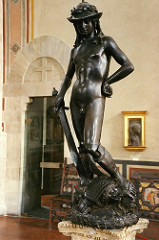 69. David Location: Florence, Italy  Artist: Donatello Date: c. 1440-1460 C.E. Period/Style: Early Italian Renaissance Medium/Material: Bronze Theme(s): humility and victory Form: exaggerated contrapposto, life-size, androgynous, nonchalance Function: ... Content: head lowered to suggest humility; Laurel on hat indicates David was a poet (hat is a foppish Renaissance design) Context: first large bronze nude since antiquity Cross Cultural Connection(s): Seated Boxer