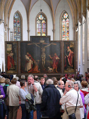 77. Isenheim alterpiece Location:  Artist: Matthias Grünewald Date: c. 1512-1516 C.E. Period/Style: Northern European Renaissance Medium/Material: Oil on wood Theme(s): Form: extreme detail Function:  Content: Crucifixion in the central panel,  Context: in a hospital Cross Cultural Connection(s):