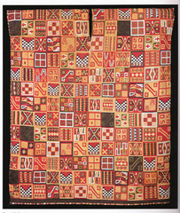 All-T'oqapu tunic -Camelid fiber and cotton. -Inka.  -1450-1540 C.E.  function: exchange of high-status goods, Inka expression of power (royal tunic), to be worn by those of high rank in society  context: textiles and their creation had been very important in the Andes long before the Inka came to power in the mid-15th century