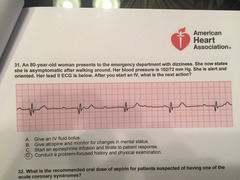An 80-year-old woman presents to the emergency department with dizziness. She now states she is asymptomatic after walking around. Her blood pressure is 102/72 mm Hg. She is alert and oriented. Her lead II ECG is below. After you start an IV, what is the next action?