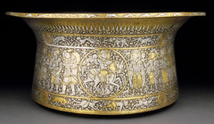 Basin (Baptistere de St. Louis) Muhammad ibn al-Zain. 1320-1340ce brass inlaid with gold and silver