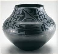 Black-on-black ceramic vessel -Blackware ceramic. -Tewa, Puebloan, San Ildefonso Pueblo, New Mexico. -c. mid-20th century C.E.  -Artist: Maria Martínez and Julian Martínez,  function: pots were used in the Pueblos for food storage, cooking, and ceremonies  context: Maria Martinez was the best-known Native potter of the twentieth century 1887-1980 and she learned ceramic techniques that were used in the SW of 1000 years