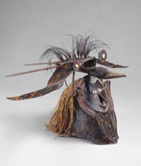 Buk (mask) mid to late 19th century CE turtle shell, wood, fiber, feathers, shell Torres Strait #218  -part of an elaborate costume that would be worn by a dancer and seen at rituals for the harvest, funerary rituals, etc. -could represent a hero, ancestor, or the bird on the top of the mask could be associated somehow with the human face -strong connection between man and supernatural