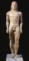 ID: Anavysos Kouros. Ancient Mediterranean. Archaic Greek. C. 530 BCE. Marble with remnants of paint. Form: marble with remnants of paint, nude, muscular, archaic, represents the people Function: spiritual connection Content: tall man who is muscular shows his strength Context: Greek