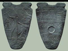 ID: Palette of King Narmer. Ancient Mediterranean. Predynastic Egypt. 3000-2920. Greywacke. Form: carved palette, smooth greyish-green siltstone, decorated both faces Function: grinding and mixing cosmetics but also ritual object Content: the king is represented as a symbol of power, seems as he is crushing his opponents. The crowns were believed to have divine power Context:early egyptian art