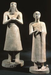 ID: Statues of votive figures. Ancient Mediterranean. Square temple at Eshnunna(modern Tell Asmar, Iraq). Sumerian 27000 BCE. Gypsum inlaid with shell and black limestone.  Form: limestone, alabaster, gypsum 30