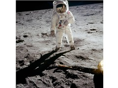 It shows a person standing on the most distant world ever visited by a human being.