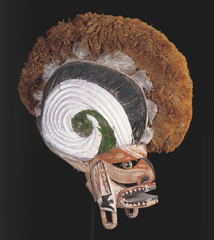 Malagan display and mask. New Ireland Province, Papua New Guinea. c. 20th century C.E. Wood, pigment, fiber, and shell.