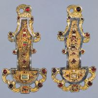 Merovingian looped fibula. Early Europe and Colonial Americas. Early medieval europe. mid sixth century CE. silver gilt worked in filigree, with inlays of garnets and other stones Form: silver gilt worked in filigree(fine gold or silver wire), decorated with garnets, amethyst, and colored glass, body, a pin, and a catch, 4 inches Function: hold clothing(such as cloaks) for higher class and military; decoration. Content: artists favore flat and abstract rep of people and animals, religious Context: 6th century, frankish kingdom experienced various internal and external struggles use of military, found in a visigothic grave site in spain