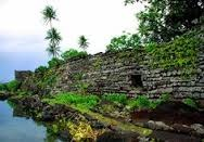 Nan Madol  Pohnpei, Micronesia. Saudeleur Dynasty. c. 700-1600 C.E. Basalt boulders and prismatic columns The megalithic architecture that characterizes the site consists of long, naturally prismatic log-like basalt stones which were often built up over foundations of large basalt boulders to form high-walled rectangular enclosures. This type of architecture occurs only sporadically on the main island which suggests that the people who used these structures were of very high status.