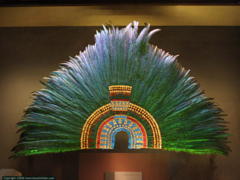 Ruler's Feather Headdress (probably Motecuhzoma II) -Feathers (quetzal and cotinga) and gold. -Mexica (Aztec).  -1428-1520 C.E.  function: for the emporer, king, or ruler to wear; it was a part of costumes and very important to culture for it was meant to be seen worn for movement (not static)  context: Long distance trade is happening, feathers came from birds in Costa Rica.