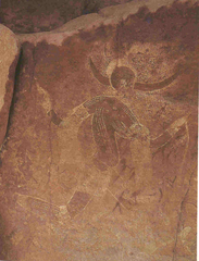 Running horned women Tassili n'Ajjer, Algeria. 6000-4000 B.C.E. Pigment on rock.  The painting shows great contrast between the dark and light mediums used. There is also great detail put into the decorations of the woman. Most interestingly, though, there is a transparency to the larger woman and the figures behind her show through.