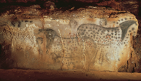 Spotted horses and negative hand imprints, wall painting in the cave at Pech-Merle, France
