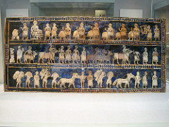Standard of Ur from the Royal Tombs at Ur (modern Tell el-Muqayyar, Iraq). Sumerian. c. 2600-2400 B.C.E. Wood inlaid with shell, lapis lazuli, and red limestone.