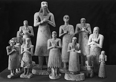 Statues o votive figures, from the Square Temple at Eshnunna. Sumerian. c. 2700 bce. Gypsum inlaid with shell and black limestone