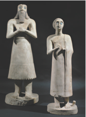 Statues of votive figures, from the Square Temple at Eshnunna (modern Tell Asmar, Iraq). Sumerian. c. 2700 B.C.E. Gypsum inlaid with shell and black limestone.