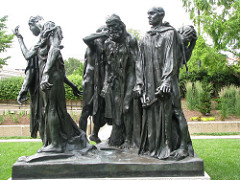The Burghers of Calais Auguste Rodin. 1884-1895 C.E. Bronze He accomplished this by not only positioning each figure in a different stance with the men's heads facing separate directions, but he lowered them down to street level so a viewer could easily walk around the sculpture and see each man and each facial expression and feel as if they were a part of the group, personally experiencing the tragic event.
