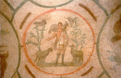*Title:* Good Shepherd Medallion  *Artist:*  *Period/Style:* Late Antique / Early Christian  *Date:* 200-400 CE  *Patron:*  *Original Location:* Orant Fresco, Greek Chapel, Catacomb of Priscilla, Rome  *Material:* paint on volcanic rock  *Subject:* male sheep (rams) but no horns b/c baby rams and don't want to mistake them for goats (goats are bad)  *Technique and Description:* -fresco -medallion -lunettes (surrounding medallion) -funerary and didactic functions  *Context:* -surrounded by lunettes -According to St. Paul, God sacrificed Jesus to erase the original sin started with Adam and Eve's actions -Early Christian art looks very Roman (evidence of syncretism/appropriation in art; also likely bc Jews didn't make art to mimic so turned to secular inspirations), was somewhat private (open to Christians but hidden b/c perfection), combination of naturalism and abstraction, had funerary and didactic functions -start breaking 2nd Commandment b/c a lot of people illiterate  *Message/Meaning:* -Jesus =
