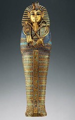 Tutankhamun's tomb, innermost cofffin. Ancient Mediterrean. New Kingdom, 18th dynasty. c. 1323. Gold inlay of enamel and semiprecious stones. Form: carved in wood, covered in gold has lapis lazuli on it. 3 coffins: crafted in wood and covered in gold with semiprecious stones(lapis lazuli and turquoise). inner cofin made out of gold Function: coffin of the king Content: showed the high skill level of ancient egypt Context: ruled after his father Akhenaten, follower of Amun, only 9 years when he became king, a royal burial ground located on the west bank of the ancient city of Thebes