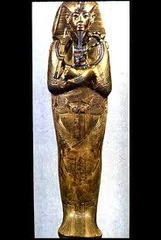 Tutankhamun's tomb, innermost coffin. New Kingdom, 18th Dynasty. c. 1323 B.C.E. Gold with inlay of enamel and semiprecious stones.
