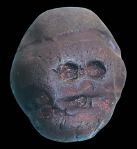 Waterworn pebble resembling a human face, from Makapansgat, South Africa